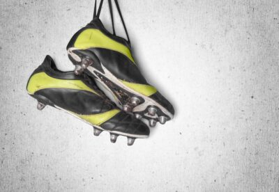 stock-photo of hanging football boots with cleats isolated